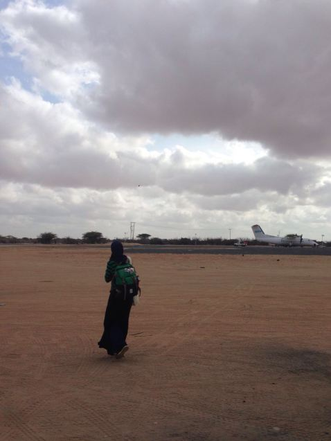 Hawa walking across the airstrip in Dadaab
